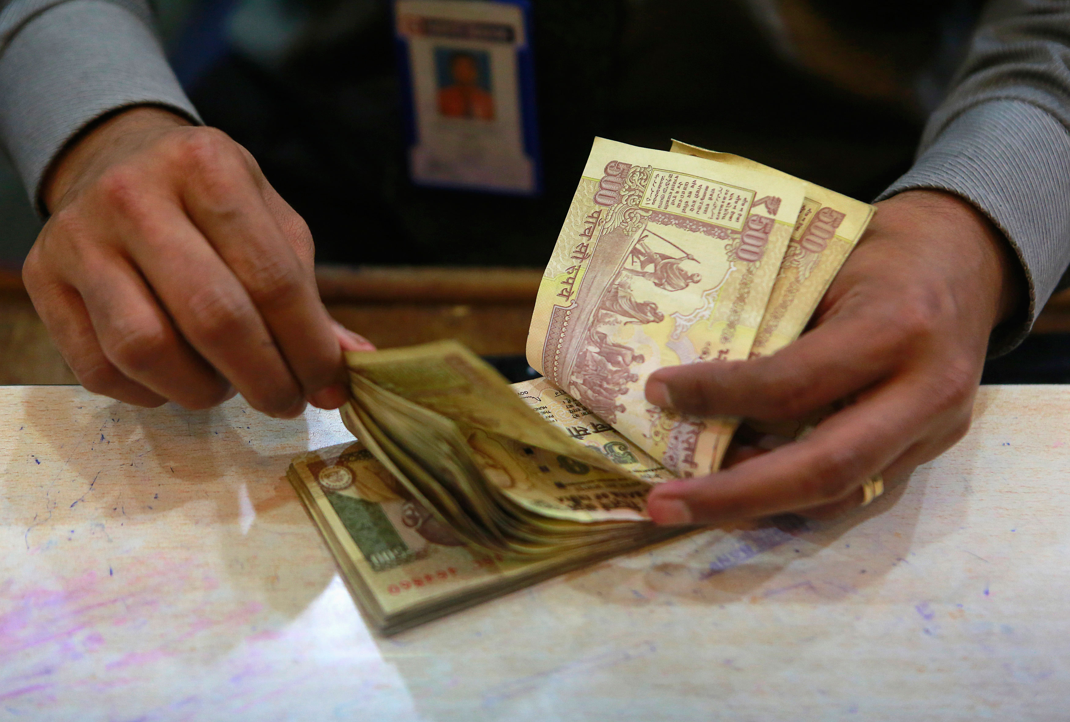 Rupee dips to 13-month low Vs US dollar