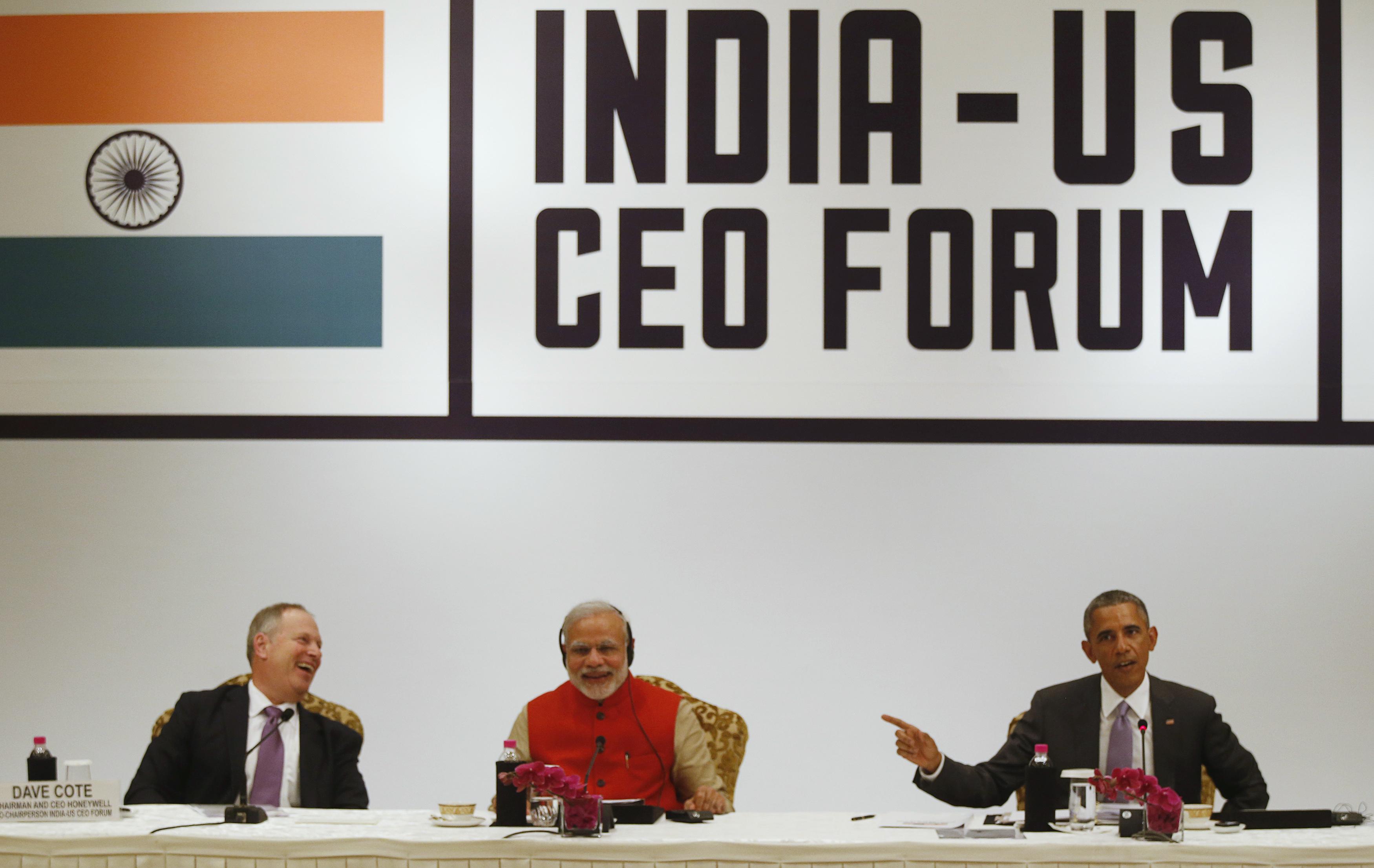 Modi promises predictable tax regime; Obama raises IPR issues