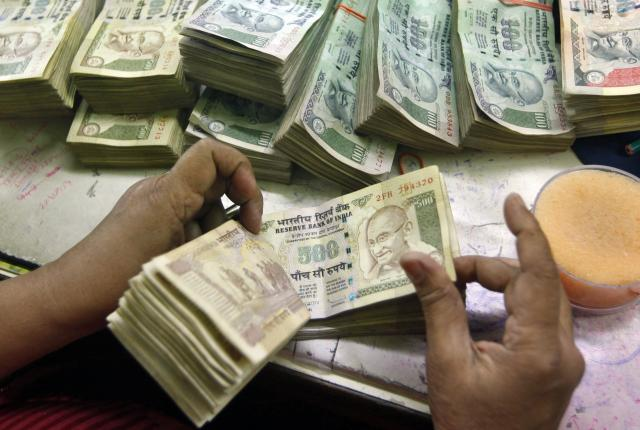 Rupee hits 20-month low, ends at 64 against US dollar
