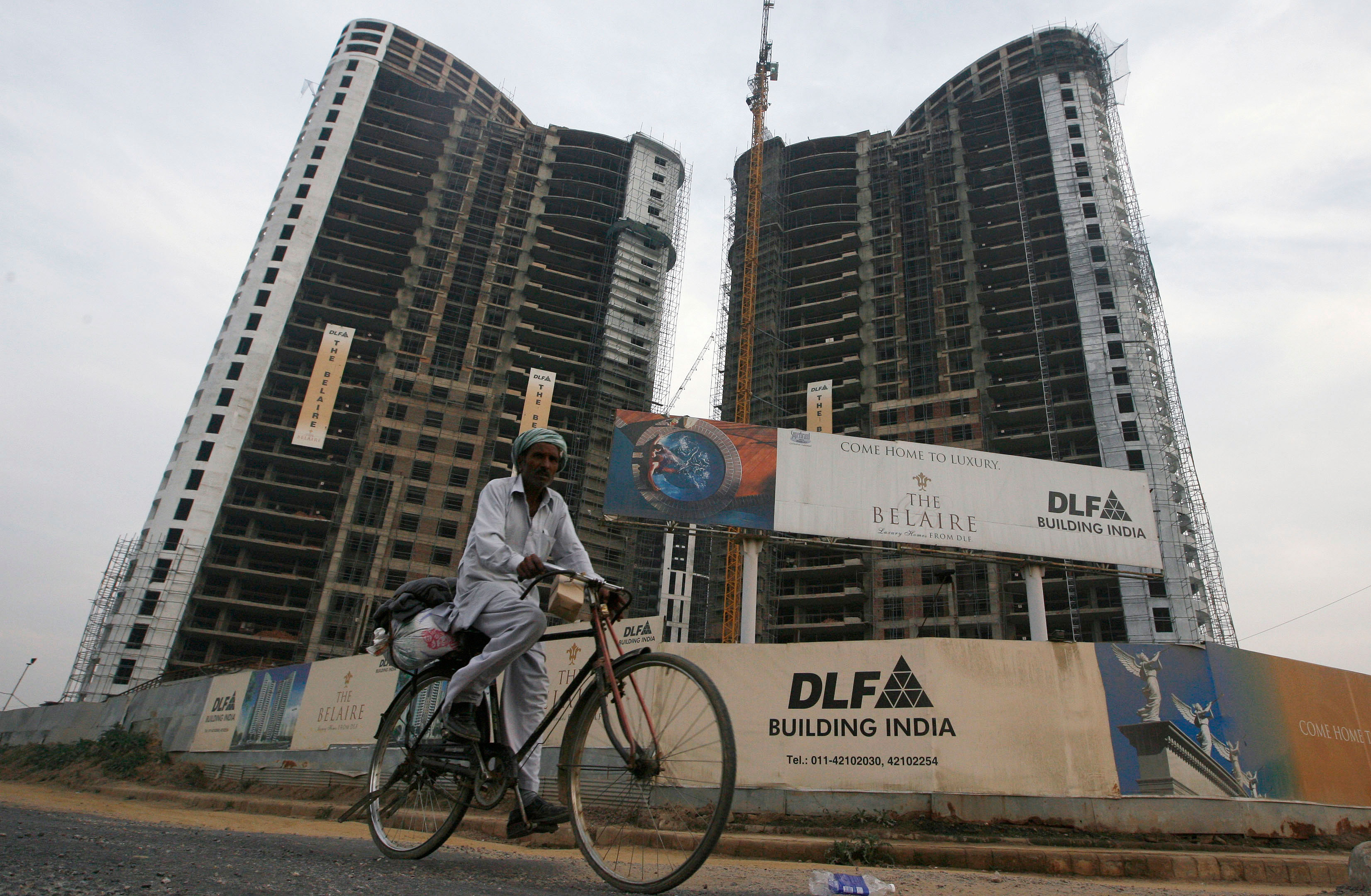 DLF appoints bankers to sell promoters' stake in rental business