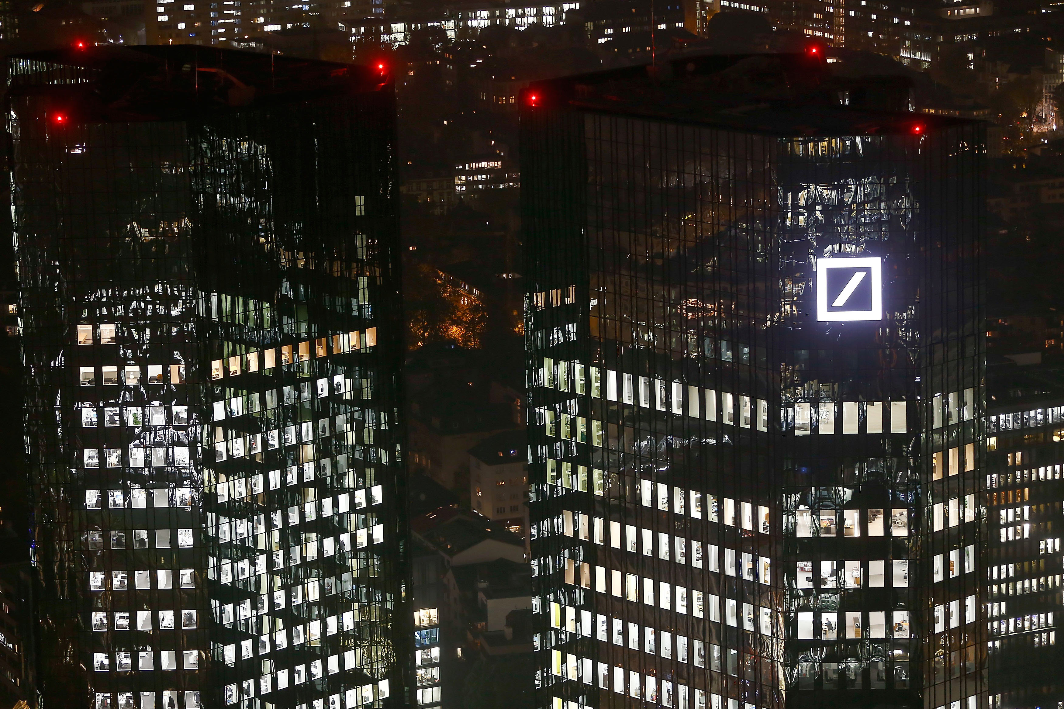Deutsche Bank to shed one in three jobs, exit 10 countries