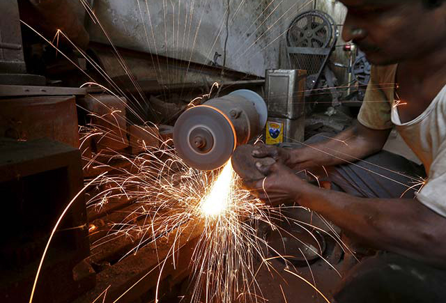 India manufacturing output edges up in May