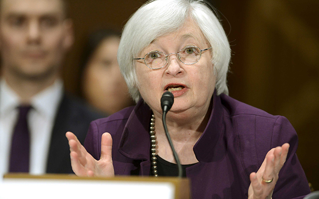 US Fed keeps rates on hold, hints at hike later