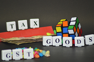 GST will take about a year to become a reality
