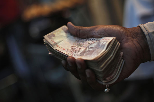 Rupee slumps to nine-month low