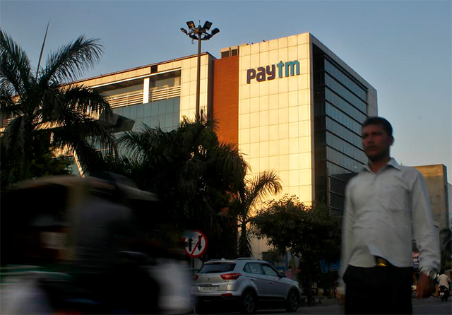 What prompted Paytm to roll back 2% fee on wallet top-up via credit cards?