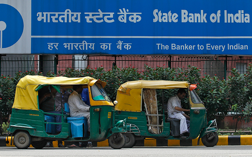 Carlyle to buy 26% in State Bank of India's credit card ventures