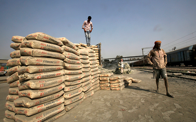 Ambuja Cement, ACC shelve merger plan; shares slip