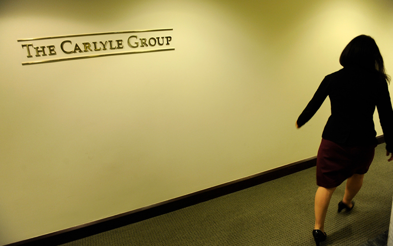Carlyle names two co-CEOs as founders step back in leadership reshuffle