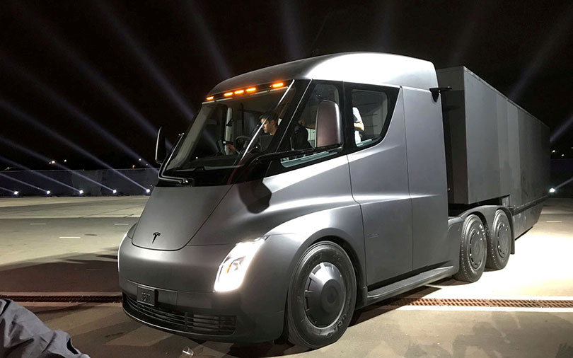 Tesla unveils electric big-rig truck, $200,000 sports car Roadster