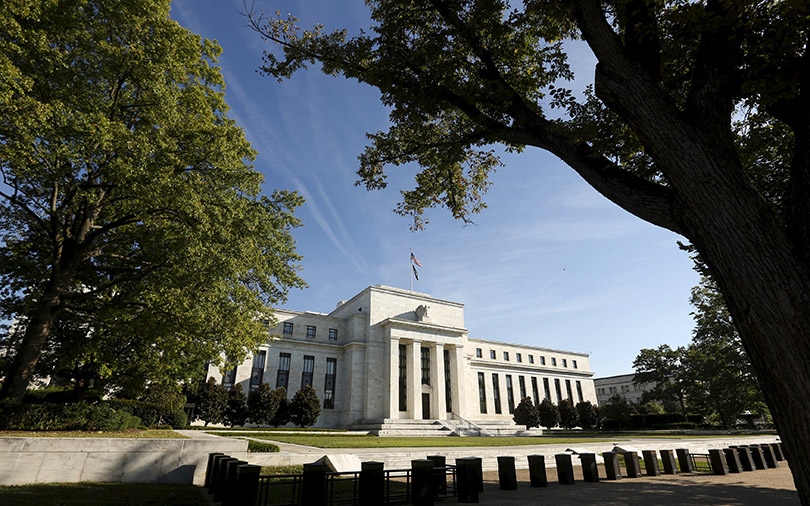 US Fed holds interest rates steady, on track for June hike