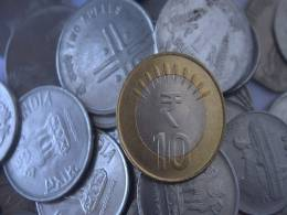 Why rupee's drop below 69 to a dollar for first time will hurt India