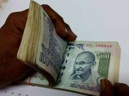 Rupee hits record low on dollar's strength, wider trade deficit