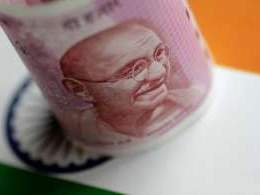 Rupee drops below 73 for first time on high crude prices