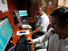 Sensex closes in the green ahead of election results