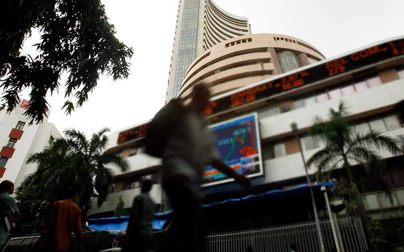 Sensex retreats from record high to trim weekly gains