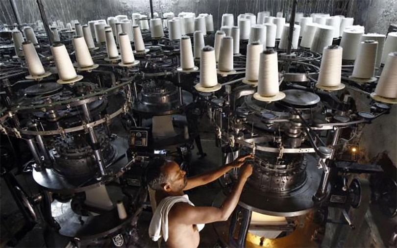 India's factory growth eases in July on weaker demand