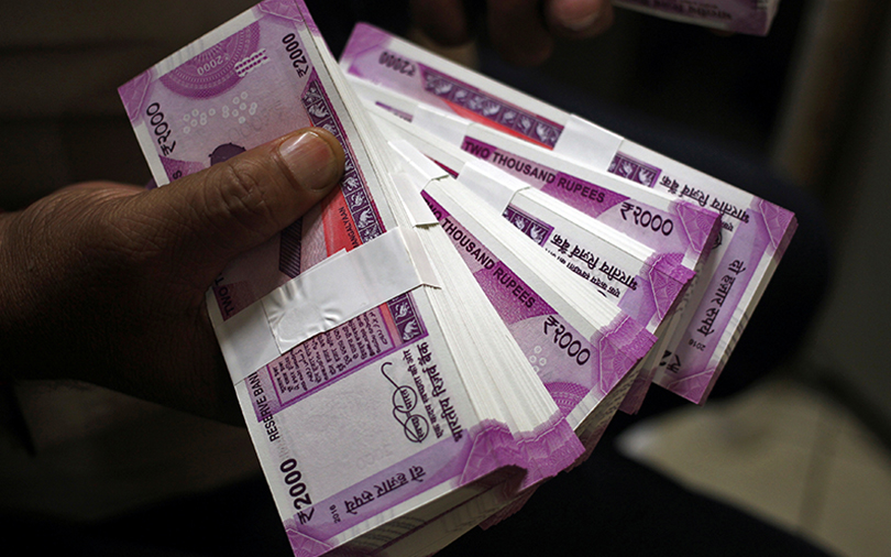 Rupee breaches 72 to the dollar for first time