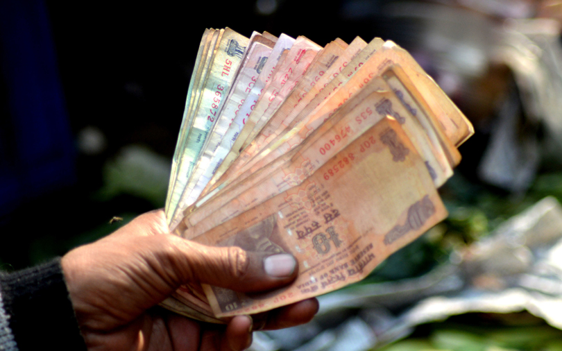 Rupee hits record low of 71 per dollar on global trade tensions