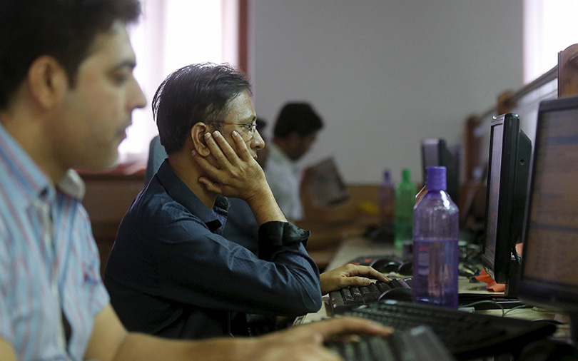 Sensex closes lower; rupee hits new low