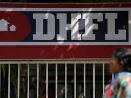 Dewan Housing shares slump on deposit curbs after rating downgrade