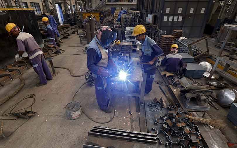 Factory growth jumps to 14-month high in February on strong demand